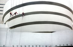 Workers cleaning the exterior of the Guggenheim Museum on Friday morning, the first such work since the museum's restoration was completed in 2008.Béatrice de Géa for The New York Times