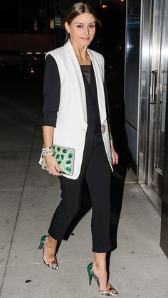 Olivia Palermo added a pop of green to her black-and-white ensemble with a Stuart Weitzman bejeweled clutch and bright snakeskin Aquazzura pumps.