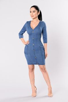 - Available in Medium Wash - V Neckline - 3/4 Sleeves - Side Pockets - Button Detail - Knee Length - Back Zipper Closure - Denim - 65% Cotton 21% Rayon 13% Polyester 1% Spandex