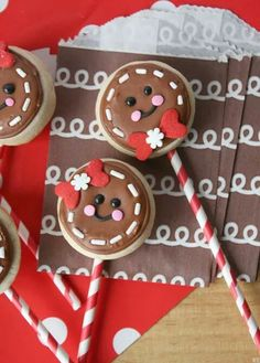 Sugar Cookie pops that look like gingerbread faces