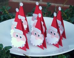How cute would these little santas be at a kids table? They are actually made with Peppermint Patties in the center with just scrapbook paper