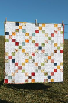 I love the simplicity of this. Could this be a baby boy quilt in blue, red, white?