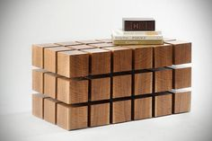At first glance, the float table appears as a solid block of wooden cubes, however upon close inspection, these cubes appear to be levitating and once touched, the cubes become slightly displaced and sway, almost bouncing to your touch.