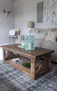 X-frame coffee Table, airy neutrals with a pop of color...definitely do not like the skull on the wall lol