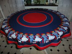 Vintage round colorful Christmas tablecloth by AnnChristinsVintage