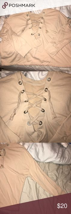 Forever 21 lace up cropped sweater WORN ONCE! size XL. Oversized a little bit. beige color. I did cut the strings at the end because it was too long. Absolutely no flaws! Forever 21 Sweaters V-Necks