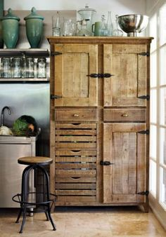 Love this kitchen armoire, with drawers