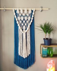 Macramé wall hanging with vibrant blue yarn. This long, lovely piece can add beauty and warmth to any room. Dowel has been trimmed to 21 inches.