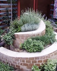 Kids are sure to love this spiral herb garden created by Eden By Design.