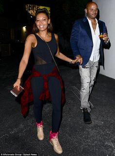 Couple's night too: The former Spice Girls singer held hands with Stephen Belafonte, her husband of nine years