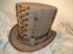 mad hatter top hat in tweed with corseting and belt loop details