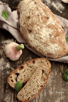Ciabatta Bread _ semi-full with garlic and basil _ Ciabatta bread is an Italian bread with an elongated, broad & payment, like a slipper. Ciabatta shape makes it extremely suitable for panini (sandwiches), so loved by Italians. It has ancient origins-dedicated to early '80s, in the province of Rovigo, the Panificio Sperimentale dei Molini di Adria Adries. Today we offer a quick & simple recipe with delicious results.