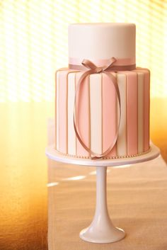 pink, pearl and latte colored 2-tier cake