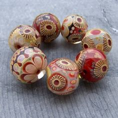 """""""Handmade Lampwork Beads by MruMru"""". Hand-made? Are you KIDDING me? These are amazing!!!"""