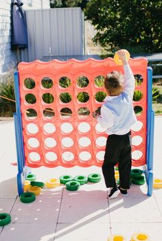 huge connect four game via 10 Effortless Ways to Entertain Kids at Weddings at EmmalineBride.com
