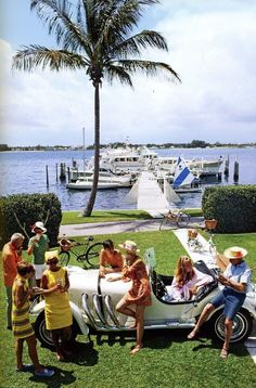 Palm Beach socialite Jim Kimberly (far left) and friends around his white sports car on the shores of Lake Worth, Florida, April (Photo by Slim Aarons/Getty Images) Jet Set, Lily Pulitzer, Vines, Les Kennedy, Serpieri, Palm Beach Florida, Positano, Amalfi, Old Money