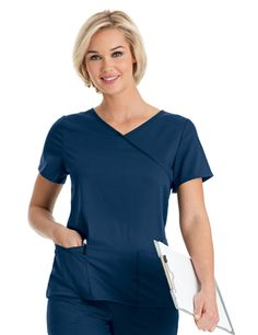 Sophie Crossover Tunic (9577) The style you love in a softer, more flexible fabric.  Crossover tunic with shaped waistline.  Six pockets and an accessory loop add function to fashion.  Tagless for even greater comfort.  54% rayon/44% polyester/2% spandex.   Medium length 25 7/8   XS - 3XL.   Available in a variety of colors at Scrubs & More, The Uniform Store.