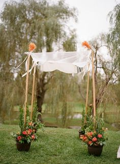 Potted Flowers Wedding Chuppah. I like how the potted flowers are holding up the poles. http://hative.com/cool-wedding-chuppah-ideas/