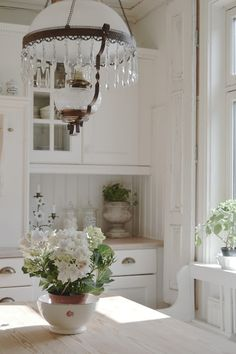 Should we end up with white cabinetry...also love the light fixture and bead board of course!