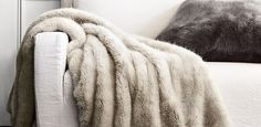 Restoration Hardware Ultra Faux Fur Throw comes in grey, white, many neutral colors add  texture