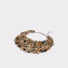 Arvan This statement necklace features many different types of beads taken from an elegant garden. Be warned, you'll be the recipient of many compliments. Bridal Jewelry, Gold Jewelry, Women Jewelry, Jewellery, Fashion Necklace, Fashion Jewelry, Jewelry Insurance, Jewelry Findings, Handbag Accessories