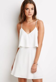Flounce Cami Dress | Forever 21  Flirty, chic, and… did we say flirty? This cami dress is all about its twirl-worthy silhouette and pretty flounce along its V-neckline. Dress it down with sandals or dress it up with heels (it's that versatile).
