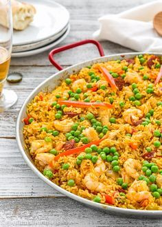This Quick and Easy  Paella recipe is easy enough for a weeknight meal, yet fancy enough to serve to dinner guests. It's studded with chorizo, chicken and shrimp. Full of  Spanish flair and amazingly tasty! http://mommyhoodsdiary.com