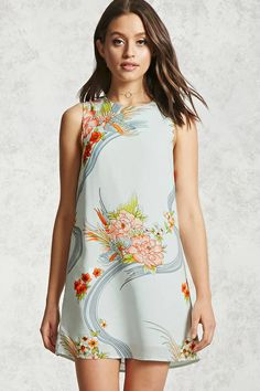A woven shift dress featuring birds, peonies, and other floral graphics, a high neckline, cutout back, sleeveless cut, and back hook-and-eye closures.