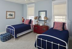 The beach house's kids room plays on the classic red, white, and blue color scheme but with a nautical twist. The space's symmetry is easy-going and pleasing to the eye.