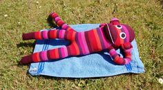Sock monkey sunbathing in unusually hot Scottish weather
