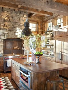 Rustic kitchen mixing stone and wood