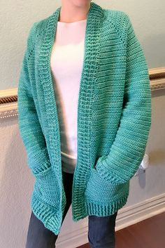 """Crochet Cardigan Ravelry: The Montana Cardigan pattern by Breon """"Brechelle"""" Lauber - The model in the photo is a size Small and is wearing a size Medium. The only sewing involved is sewing on the pockets. Cardigans Crochet, Crochet Clothes, Knit Cardigan, Chunky Cardigan, Crochet Bodycon Dresses, Black Crochet Dress, Crochet Jacket Pattern, Afghan Crochet Patterns, Crochet Afghans"""