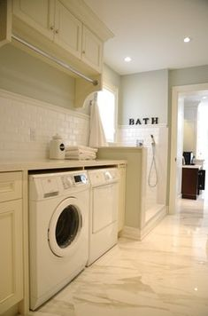 Laundry room with dog bath using white ceramic tile.