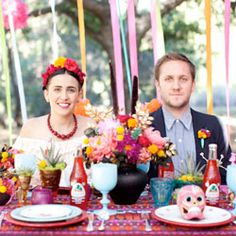 A colorful Dia de los Muertos wedding inspiration shoot. Love the Frida Kahlo bride + her floral hair piece!