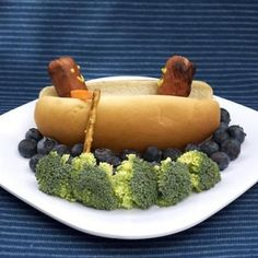 Hot Dog Canoes--because my man likes broccoli...maybe I'd make mine with cauliflower, though. And the blueberries under the canoe are just adorable!