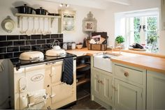 October Cottage in Cornwall: Cozy Cottage Kitchen with AGA stove.