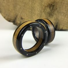 We use salvaged Oak from the 1879 Tay Rail Bridge to construct this ring - the steel rivets add an industrial feel to this contemporary wooden ring with fascinating provenance