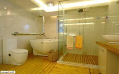 http://www.justsoakit.com/wp-content/uploads/2015/01/contemporary-wooden-flooring-in-the-bathroom-as-well-elegant-glass-shower-beside-vanity-sink-also-bright-ligting-ceiling-and-round-bathtub-corner-870x544.jpg