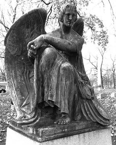 photos of statues from old cemetery in Milwaukee....