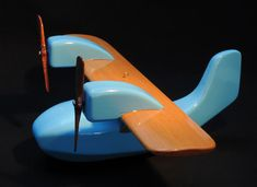Wooden Plane. Design Ole Søndergaard Wooden Airplane, Wooden Toy Cars, Wood Toys, Wooden Crafts, Wooden Diy, Toy Art, Wood Plane, Hanging Mobile, Beginner Woodworking Projects