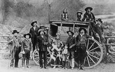 """""""Buffalo Bill"""" Cody in front of the Deadwood Stagecoach. Nelson, scout and driver sit on top with two of his Sioux children. Jule Keen, treasurer of Wild West Show, sits on back. Buck Taylor and Bronco Bill stand in front. Vintage Photographs, Vintage Photos, Antique Photos, Westerns, Old West Photos, Wild West Show, Wild West Cowboys, Into The West, American Frontier"""