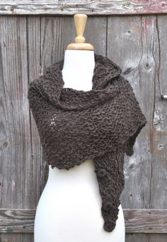 emiLIme Chunky Button Wrap Scarf - $58.00  Beautiful rich dark brown woven scarf with three detail buttons down each side. Versatile and playful, this chunky scarf can be worn in a variety of ways.