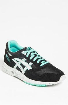 A retro road-runner style defines a cool, casual sneaker with bold contrast detailing to really catch the eye. Color(s): black/ lt. More Details Casual Sneakers, Yellow Black, Asics, Saga, Nordstrom, Road Runner, Retro, Eye Color, Contrast