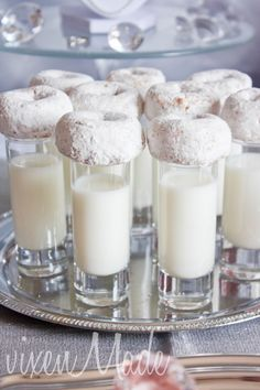 Powdered donuts (store bought) on milk shooters.