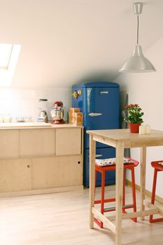 Raw birch wood cabinets made by Minim Berlin & Smeg fridge $1999.