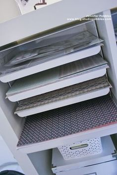 Ikea paper sorters fit into Expedit and can be altered to fit 12x12 (maybe have one of these for current projects?)