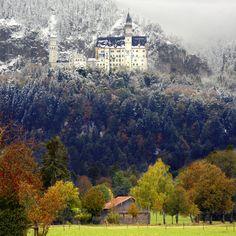All season in one photo. Neuschwanstein castle. Model for the castle of Sleeping Beauty. Bavaria Germany.