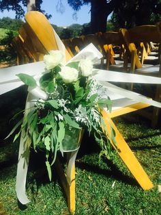 Aisle bouquets in tin rustic containers with rises and mixed greens