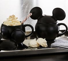 Inspired by vintage illustrations of Mickey Mouse's 1928 debut, our nostalgic new collection celebrates the magic of (C)Disney. Crafted of stoneware and finished with a glossy black finish, these mugs make everything-from your morning coffee to hot cocoa parties-all the more fun. To top it off, they come with a mouse-ear lid for steeping teas or keeping soups nice and warm. Crafted of 100% stoneware with a lid. Features a color glazed decal finish. Phthalate, BPA, lead and latex free… Pottery Barn Kitchen, Pottery Barn Teen, Mickey Mouse Ears, Disney Mickey Mouse, Stoneware Mugs, Ceramic Mugs, Mickey Mouse Kitchen, Disney Kitchen, Mickey Drawing