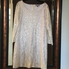 Silver and blush dress by Tinley Road. Beautiful silver lace and blush underlay dress by Tinley Road. Size Small, A-line 3/4 length lace sleeves. Bust, 18 inches across, length, 32 1/2 inches. Worn for a bridal shower once. Tinley Road Dresses Midi